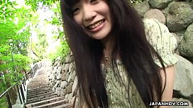 Adorable Asian brunette rubbing...