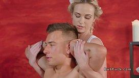 Masseuse gives foot massage...
