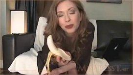 White woman eats banana...