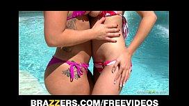 Two bikini-clad brunettes...