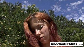 Pregnant redhead takes a facial outdoors