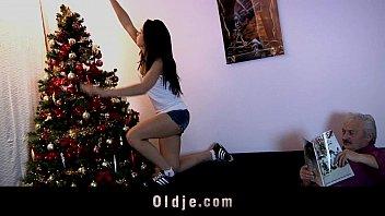 Jolly teeny fucks oldman while decorating Christmas tree