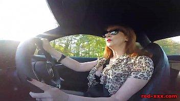 Big tit British mature Red masturbating in the car