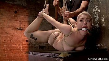 Suspended blonde pussy fucked with toy