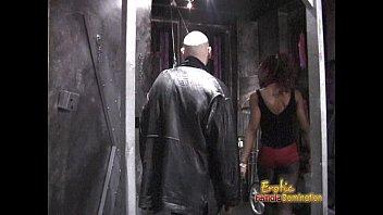 Slim ebony dominatrix pleasures a horny dude in the dungeon