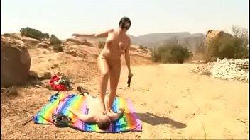 Sunbathing mature hottie punishing peeping loser