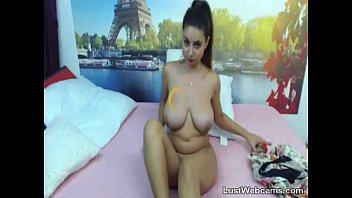 Big titted brunette teasing on webcam