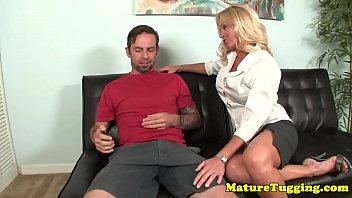 Classy MILF jerking cock until it cums