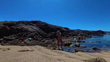 TRAVEL NUDE - Young russian nudist girl Sasha Bikeyeva  on the wild coast ocean