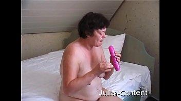 Grandma fuck herself with a dildo