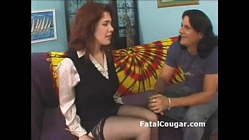 Redhead bigboob cougar in stockings kneels down and gives sloppy blowjob