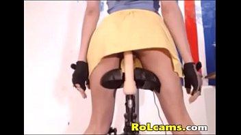 Teen riding dildo on bike Thumb