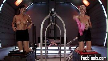 Toying lesbians spanking while machine fucked