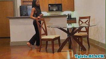 Ebony tgirl tugging her big chocolate cock