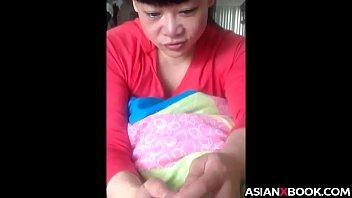 Asian babe gives nice handjob