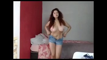 Young amateur milf topless teasing her big tits for free