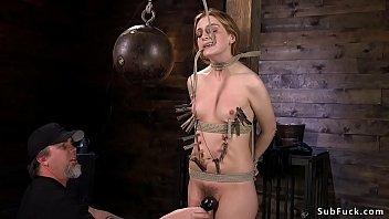 Zippered slave in bondage standing