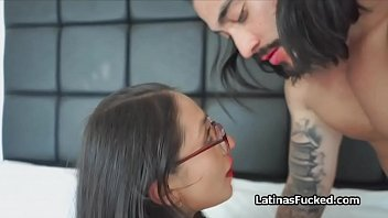 Amateur Latina cutie in glasses blows cock