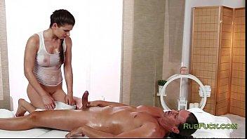 Oiled masseur fucks muscle dude