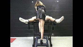 Mistress in latex gloves masturbates a naked, tied up man