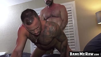 Muscle daddy barebacking with younger hunk