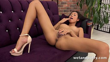 Sexy Asian strips and plays with pussy pump