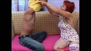 Redhead Granny in stockings taking big cock