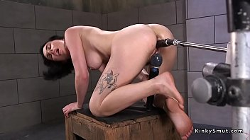 Babe fucks machine in squat position