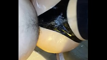 Me fucking my wife's big wet ass in latex strings in shower