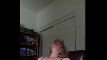 mature milf loves watching porn and masturbating