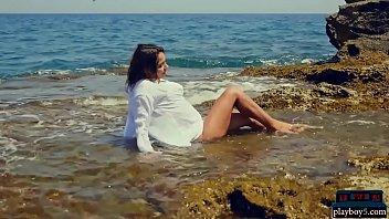 Sexy bikini teen strips naked outdoor near the sea