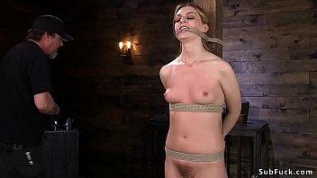Hairy brunette slave gets stick on heels
