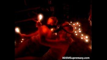 Bizzare BDSM play in dark dungeon where