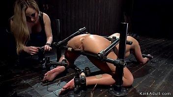 Lezdom whip and spank in device bondage