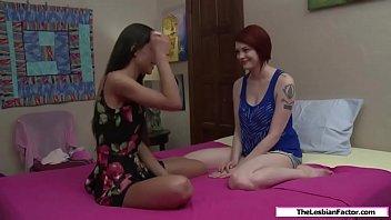 Sexy redhead fingering her skinny friend