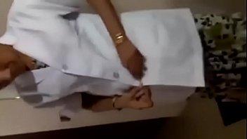 Tamil nurse remove cloths for patients