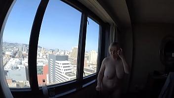 MarieRocks naked overlooking the city