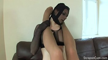 Two horny girls that love to encase themselves in black pantyhose.