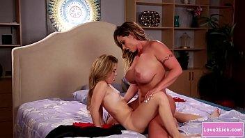 Teen babe scissoring with her stepmom