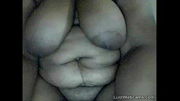 Ebony BBW sucks dildo on webcam