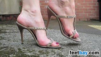 Walking Outdoors In Sexy High Heels