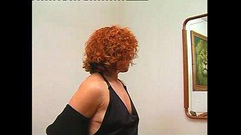 Curly redhead masturbates