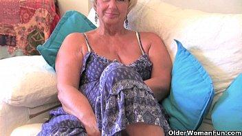 British granny with big tits masturbates with h...