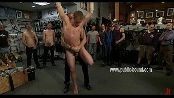 Gay man suspended in ropes from ceiling