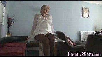 Classy blonde mature teasingly rubs clit