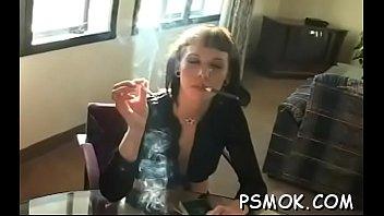 Horny babe smoking while giving a fellatio to her man