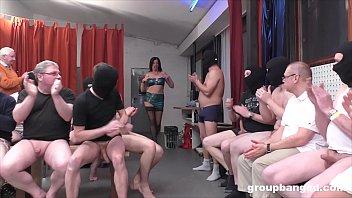 Slutty milf stripper gets covered in cum during a gangbang