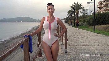 Wet transparent  swimsuit in public blic