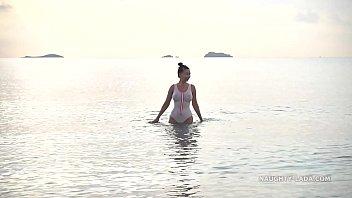 Wet transparent swimsuit in public