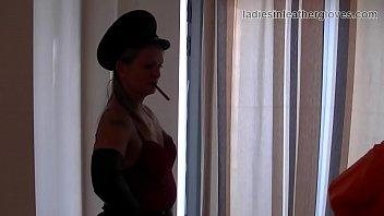Leather clad smoking mistress domination